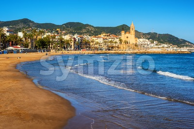 Sand beach and historical Old Town in mediterranean resort Sitges, Spain Stock Photo