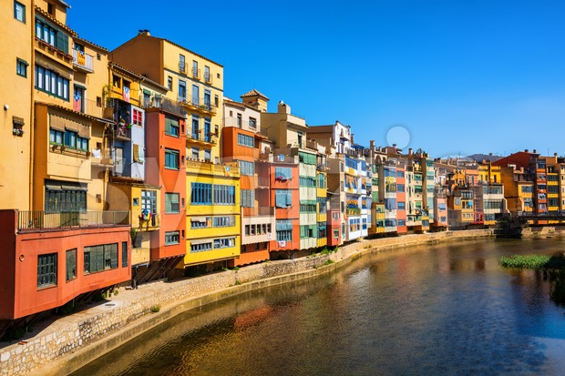 Traditional colorful facades in Girona Old Town, Catalonia, Spain on a bright, sunny day