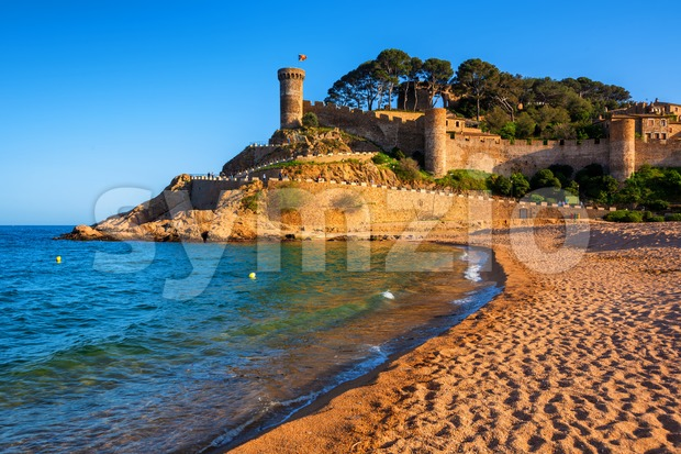 Tossa de Mar, the sand beach beneath the historical Old Town walls on Costa Brava mediterranean coast, Catalonia, Spain