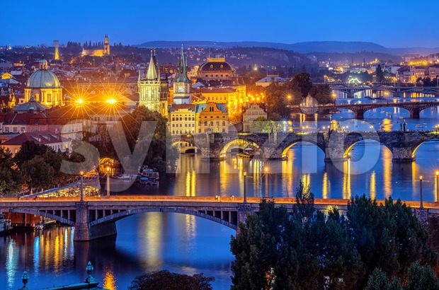 Prague city, Czech Republic, view of the bridges over Vltava river and the Old Town in blue evening light