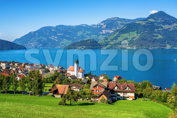 Traditional village on Lake Lucerne in swiss Alps, Switzerland Stock Photo