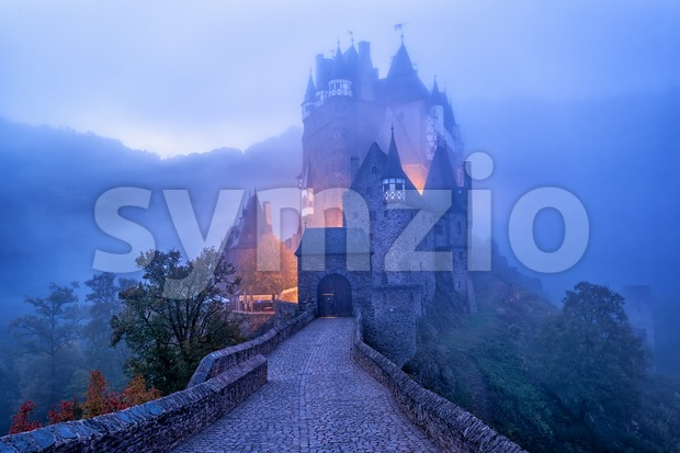 The medieval gothic Burg Eltz castle in the morning mist, Germany Stock Photo