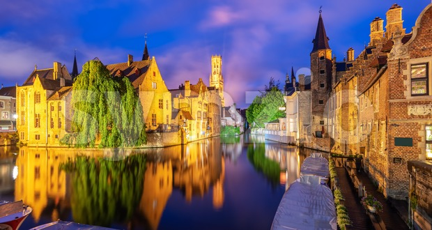 Panoramic view of the Rozenhoedkaai canal, historical brick houses and the Belfry in Bruges medieval Old Town, Belgium, a UNESCO ...