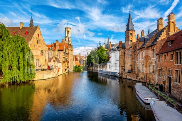 The Rozenhoedkaai canal, historical brick houses and the Belfry in Bruges medieval Old Town, Belgium, a UNESCO World Culture Heritage ...