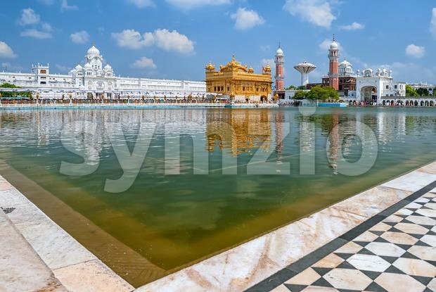 Golden Temple Harmandir Sahib, a main Sikh Gurdwara religious site, reflecting in sacred pool, Amritsar, Punjab, India