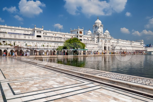White palace, marble walled court and sacred pool of the Golden Temple, Amritsar, Punjab, India