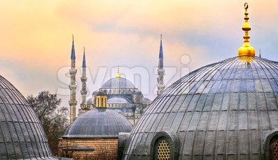 Domes of Blue Mosque in Istanbul on sunset Stock Photo