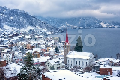 Weggis village on Lake Lucerne, swiss Alps mountains, Switzerland, in winter time Stock Photo