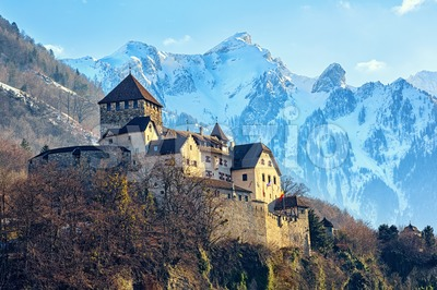 Vaduz Castle, Liechtenstein, with snow covered Alps mountains in background Stock Photo