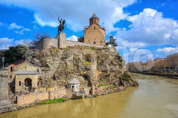 Tbilisi city, Georgia, historical orthodox Metekhi Church on a rock over Kura river