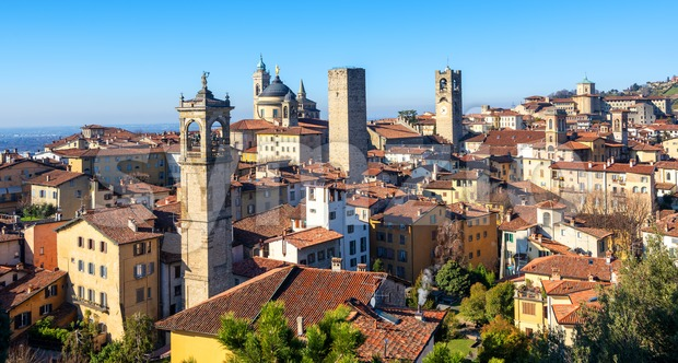 Bergamo, panoramic view over the red tile roofs and towers of medieval historical Old Town, Lombardy, Italy
