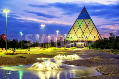 Astana, Kazakhstan, the Pyramid of Peace and Accord on sunset Stock Photo