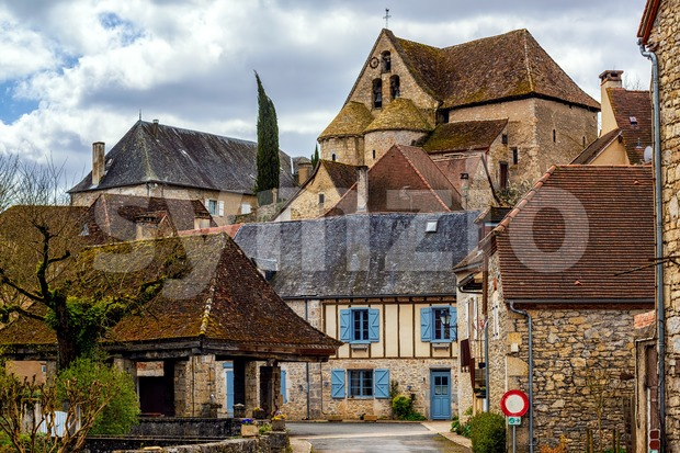 Creysse, a typical french village in Haut Quercy, Lot department, Martel, France, with traditional blue window shutters, brown brick buildings, ...