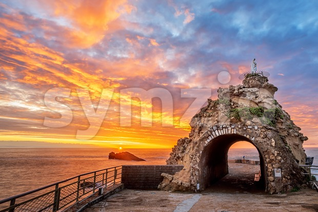 Biarritz, France, Rock of the Virgin (Rocher de la Vierge) on dramatical sunset over Atlantic ocean