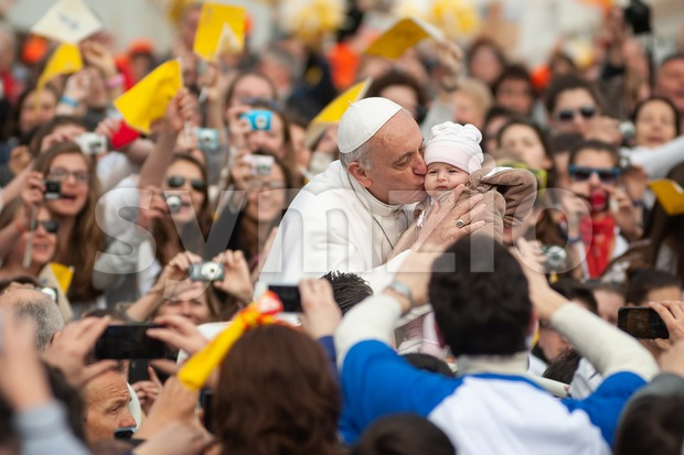 Rome, Italy - April 04: His Holiness Pope Francis I kisses a child during a prayer in front of St ...