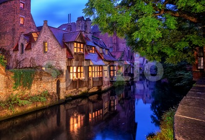 Bruges Old Town, Belgium. Traditional medieval houses at night. Stock Photo