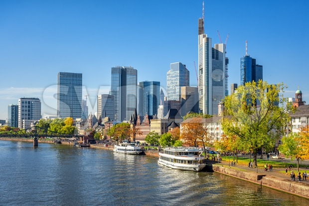 Frankfurt am Main, Germany, view of the modern financial district skyline and historical Main river riverside with cruise boats