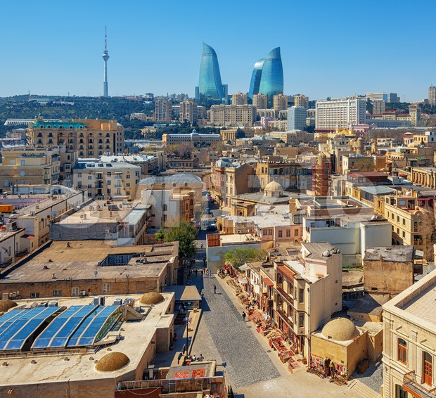 Baku city, aerial view over the Old town and modern skyline with iconic Flame Towers building, Azerbaijan