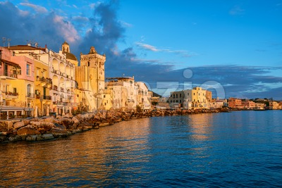 Ischia town waterfront on sunset, Italy Stock Photo