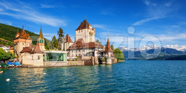 Oberhofen castle on Lake Thun in the Alps mountains, Canton Bern, Switzerland, panoramic view