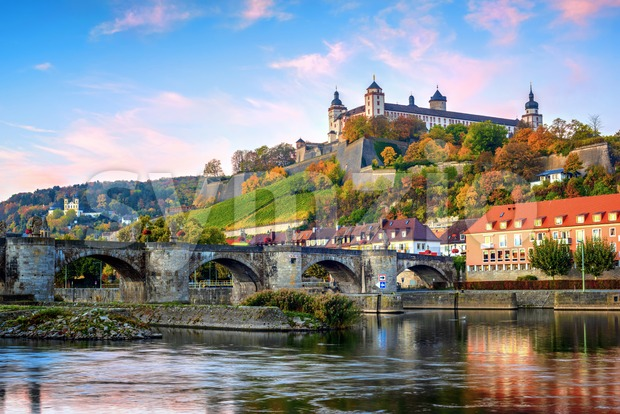 Wurzburg, Bavaria, Germany, view of the Marienberg Fortress and the Old Main Bridge on colorful sunrise