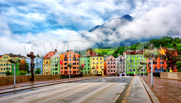 Traditional colorful houses in Innsbruck city on a fresh cloudy morning, Tyrol, Alps mountains, Austria