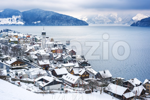 Lake Lucerne, Switzerland, view of Beckenried village and Alps mountains covered with white snow at winter timer