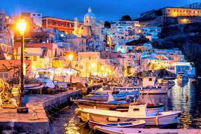 Procida island, Old town port at night, Italy Stock Photo