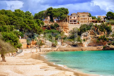 Seaside villas over the sand beach, Mallorca, Spain Stock Photo