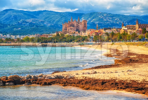 Sand beach in Palma de Mallorca, gothic cathedral in background, Spain Stock Photo