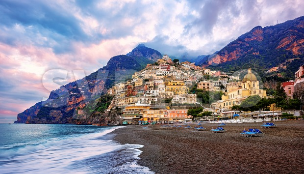 Positano, a town on Amalfi coast, Naples, Italy, dramatically set on a steep cliff between Mediterranean sea and mountains, is ...