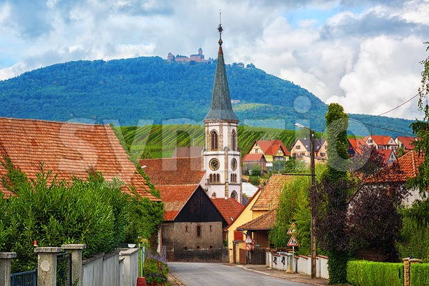 Rorschwihr village on the Alsace Wine Route with Haut Koenigsbourg castle on a hill in background, France
