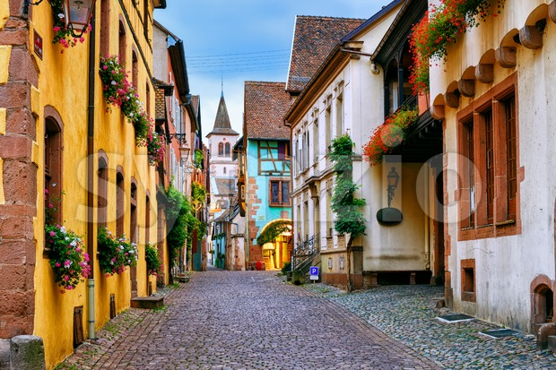 Traditional colorful houses on a street in Riquewihr, a beautiful town on the Alsace Wine Route, France