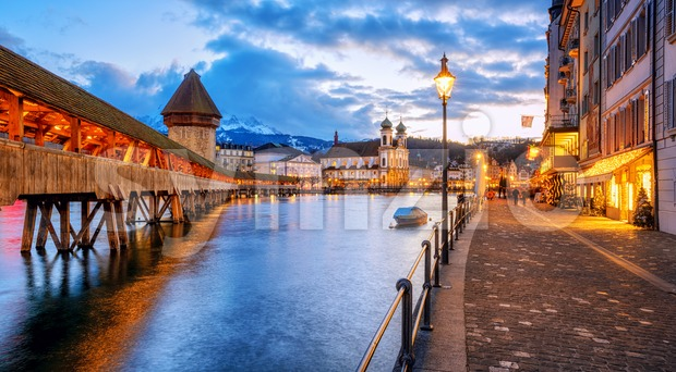 Lucerne Old town center with view of wooden Chapel bridge, Water tower, Mount Pilatus and riverside promenade, Switzerland