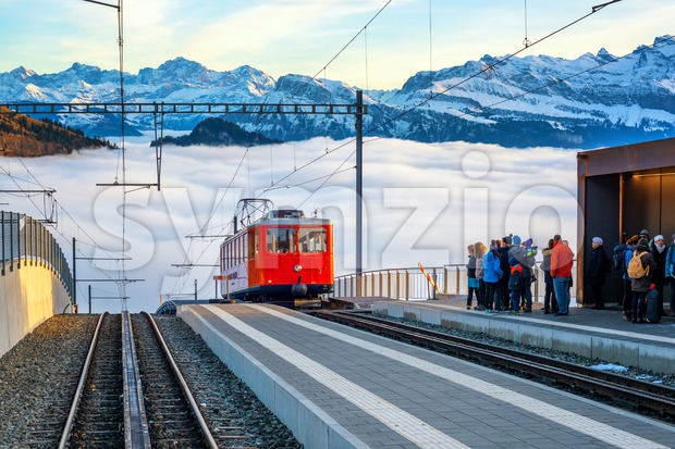 Rigi Kaltbad, Switzerland - January 01, 2016: Train arrives at the railway station in the Alps. Rigi railway, operating from ...