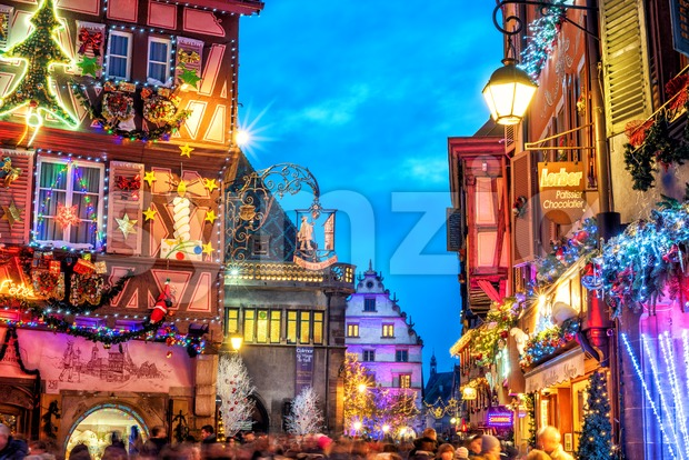 Colmar, France - November 23 2019: Central street Grand Rue decorated and illuminated for Christmas celebrations. Traditional Christmas market in ...