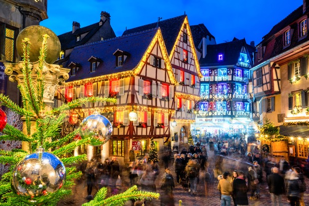 Colmar, France - November 23 2019: Traditional illuminated Christmas market in the Old town of Colmar, Alsace. Christmas market in ...
