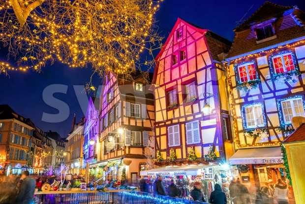 Colmar, France - November 23 2019: Traditional illuminated Christmas market on a street of Old town in Colmar, Alsace. Christmas ...