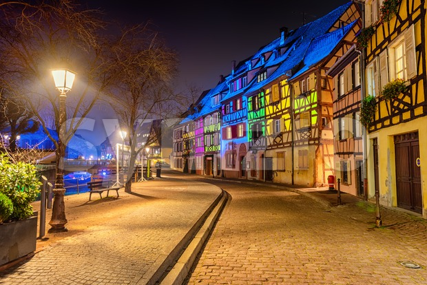 Colmar, Alsace, France, traditional historical half-timbered houses in medieval Old town colorful illuminated for Christmas celebrations