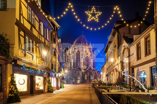 Beautiful Christmas illumination on a street in historical Old town of Colmar, Alsace, France