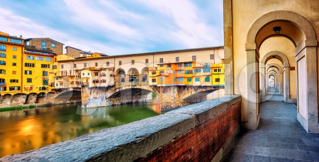Ponte Vecchio bridge and riverside promenade in Florence, Italy Stock Photo
