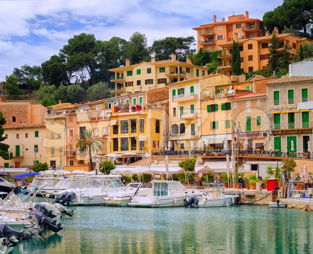 Motor boats and traditional waterside houses in Puerto Soller, Mallorca, Spain
