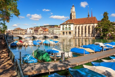 Boats on Limmat river in Zurich city center, Switzerland Stock Photo