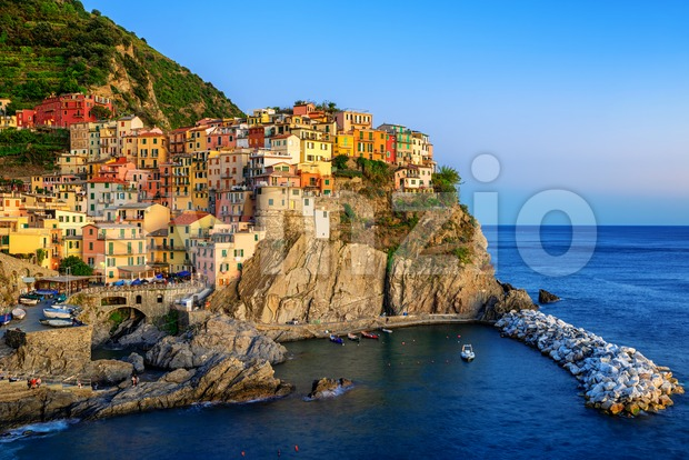 Manarola, Italy, a picturesque village in Cinque Terre, in blue evening light