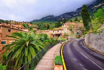 Mountain road winding through little spanish town, Spain Stock Photo