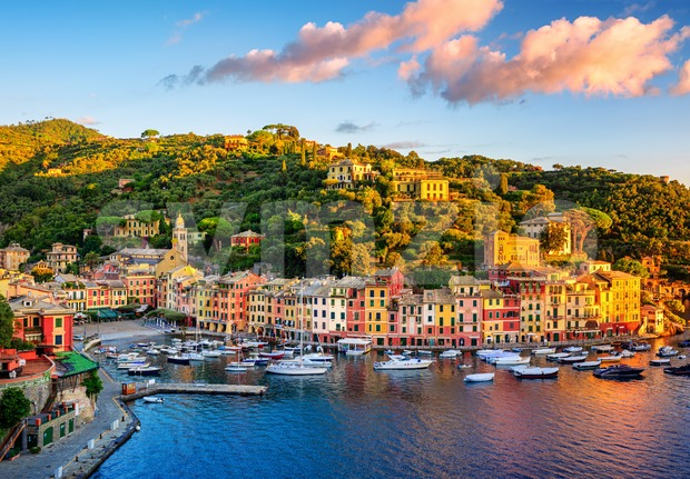 Beautiful sunrise over Portofino, Italy, a picturesque fishing village with colorful houses and a small harbor on italian Riviera near ...