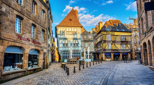 Dinan, France - 13 July 2017: Historical Old town of Dinan is famous for its half-timbered medieval architecture and is ...