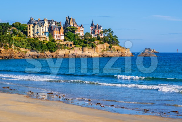 Sand beach and historical villas in Dinard, Brittany, France. Dinard is a popular seaside resort on the french Atlantic ocean ...