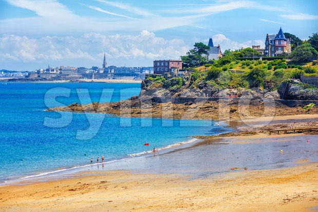 Sand beach on atlantic Emerald coast in Dinard, with view of St Malo town, Brittany, France