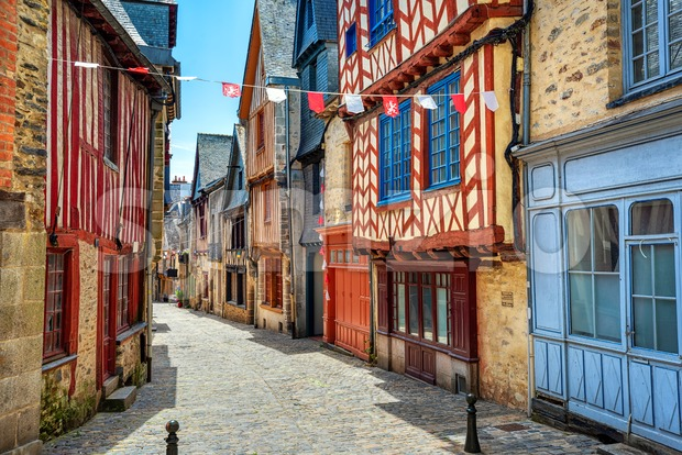 Colorful medieval half-timbered houses on a street in historical Old town Vitre, Brittany, France